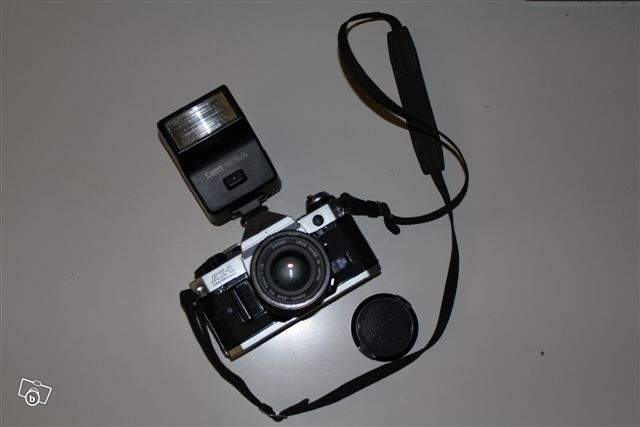 ancien appareil photos canon ae1 p avec flash speedlite 188a collection. Black Bedroom Furniture Sets. Home Design Ideas